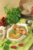 Poultry consomme with chicken skewers. On a napkin Royalty Free Stock Image