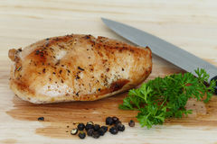 Poultry meat, turkey steak fried on wooden board Stock Photos