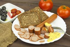Poultry sausages on a wooden table, preparing home-made snacks. Stock Image