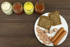 Poultry sausages on a wooden table, preparing home-made snacks. Stock Images