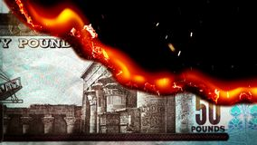 Pound bill Egyption money burning in flames stock video footage