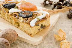Pound cake. Decorated with almonds and dried fruit Royalty Free Stock Image