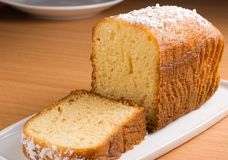 Pound cake. Sugar coated pound cake on a white platter Stock Images
