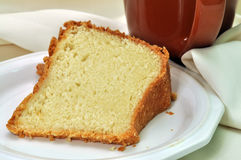 Pound Cake. Closeup of pound cake with napkin and cup of coffee in background Royalty Free Stock Image