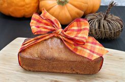 Pound cake with a fall ribbon in a fall setting. Stock Images
