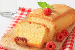 Pound cake and fresh raspberries Royalty Free Stock Photo