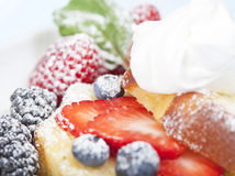 Pound cake with fruit and a whipped topping Stock Image
