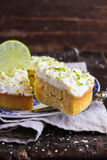 Pound cake with lemon, lime and freshly shredded coconut stock photos