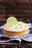 Pound cake with lemon, lime and freshly shredded coconut with cream cheese frosting, selective focus. Copy space. Stock Photo