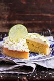 Pound cake with lemon, lime and freshly shredded coconut with cream cheese frosting, selective focus royalty free stock photography