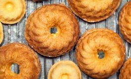 Pound cake. Many small pound cakes on a baking tray Stock Photos