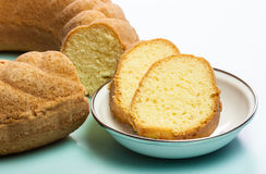 Pound Cake Slices. A macro view of the slices of a delicious golden brown crusted pound bundt cake baked in a ring shaped pan with fluted sides. The image has a Stock Photo
