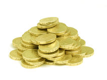 Pound Coin Pile. Pile of English pound coins on white background Royalty Free Stock Photography