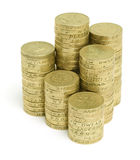 Pound Coin Stacks. Stacked English pound coins on a white background royalty free stock image