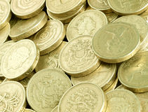 Pound Coins. Pile of scattered UK pound coins stock images