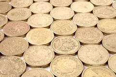 Pound Coins. A background of rows of One Pound Sterling coins Royalty Free Stock Photos