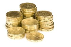 Pound Coins. Stacks of british pound coin on a white background Royalty Free Stock Photos