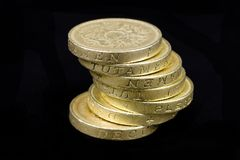 Pound Coins. Stack of british pound coin on a black background Stock Image