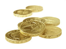 Pound coins. UK pound coins isolated on white background royalty free stock photography