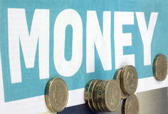 Pound coins. British pound coins with a money heading Royalty Free Stock Photography