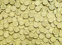 Pound Coins Background. Large quantity of scattered UK pound coins Royalty Free Stock Image
