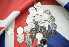 pound coins on British flag Royalty Free Stock Images