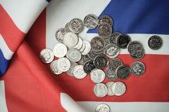 pound coins on British flag Stock Image