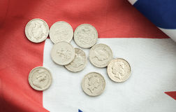 pound coins on British flag Royalty Free Stock Photos