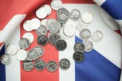 pound coins on British flag Stock Photo