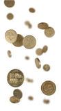 Pound coins falling. Pound coins shot as if falling with blur to simulate depth Royalty Free Stock Photo