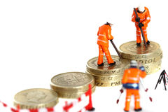 Pound coins miniature figures C Royalty Free Stock Images