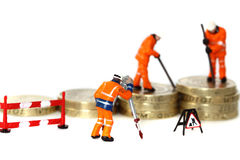 Pound coins miniature figures A Stock Photo