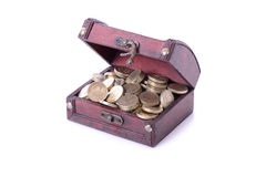 Pound coins in a treasure chest Royalty Free Stock Images