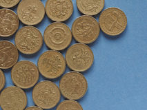 Pound coins, United Kingdom over blue with copy space Royalty Free Stock Image