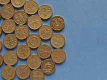 Pound coins, United Kingdom over blue with copy space Royalty Free Stock Photos