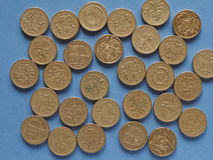 Pound coins, United Kingdom over blue Stock Image