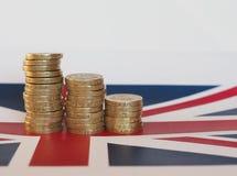 Pound coins, United Kingdom over flag Stock Photos