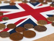 Pound coins, United Kingdom over flag Stock Photo