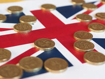 Pound coins, United Kingdom over flag Royalty Free Stock Image