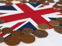 Pound coins, United Kingdom over flag. Pound coins money (GBP), currency of United Kingdom, over the Union Jack Royalty Free Stock Photography