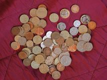 Pound coins, United Kingdom over red velvet background Stock Images