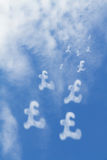 Pound currency clouds Stock Photo