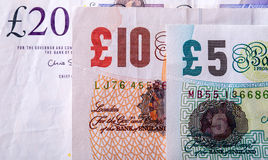 Pound currency, money, banknote.  English currency. UK banknotes of different values stacked on each other Stock Images