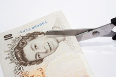 Pound cutting. Cutting your money down to size Stock Photography