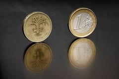Pound and Euro. One UK pound and One euro close togeter Stock Photos