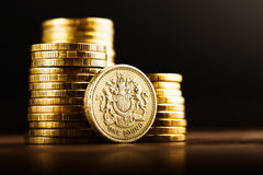 Pound GBP coin and gold money Stock Photo