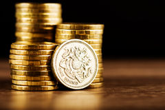 Pound GBP coin and gold money Royalty Free Stock Photography