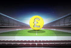 Pound golden coin in midfield of magic football stadium Stock Images