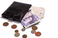 Pound money and black wallet Royalty Free Stock Images