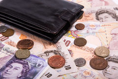 Pound money and black wallet Stock Photo